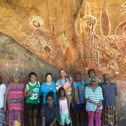 Sally Winbirr, Tilly Raymond, Naomi Rosas, Samantha Singh, Chantelle Mota, Natasha Raymond, May Rosas, Patsy Brown, Natalie Blitner, and Florrie Smiler at Nimji rock art site during the Wardaman Women's Culture Camp.